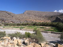 Wadi Ghul. View on Wadi Ghul with abandoned village in the background Royalty Free Stock Photo