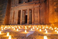 WADI MUSA, JORDAN - NOVEMBER 17, 2012:  Touristic night candle ceremony in ancient Petra city. Petra is historical and archaeologi Stock Photos