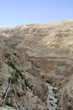 Wadi Qelt aqueduct near Jericho. Ancient water conduit in wadi Qelt in Judea desert, Israel Royalty Free Stock Photography