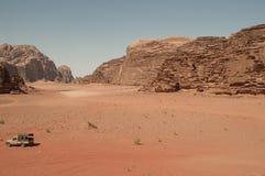 Wadi Rum. Truck in Wadi Rum wide desert Royalty Free Stock Photos