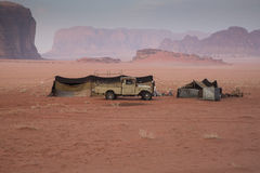 Wadi Rum bedouin tent. A Bedouin tent and jeep in the Wadi Rum desert during sunset stock photography