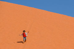 WADI RUM DESERT, JORDAN - APRIL 30, 2016: Little girl on sand dune Stock Photography