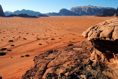 Wadi Rum desert, Jordan. Wadi Rum (Arabic: وادي رم) also known as The Valley of the Moon (Arabic: وادي القمر) is a valley cut into the Stock Image