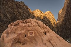 Wadi-Rum desert Jordan, this photo shows the different golden colors on the mountains and rocks at sunset, in the foreground the p. Ortrait with signature royalty free stock photo