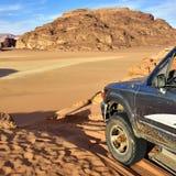 Wadi Rum desert. Off-road car shown in the Wadi Rum desert. Extreme desert safari is one of the main local tourist attraction in Jordan royalty free stock image