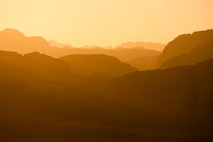 Wadi Rum - distant Hills in Sunset. Sun is setting Distant mountains lit by the setting sun in the Wadi Rum desert reservation, Jordan stock photos