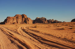 Wadi Rum, Jordan. Evening landscape in Wadi Rum desert with tracks on the sand Royalty Free Stock Photography