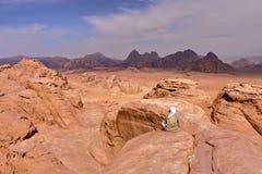 WADI RUM, JORDAN: A Jordanian man overlooking the Wadi Rum desert from the top of a mountain Royalty Free Stock Images