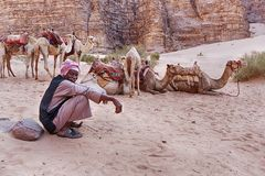 Resting Camel Herder Royalty Free Stock Photos