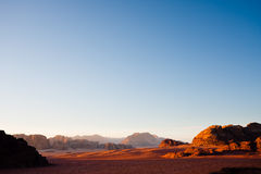 Wadi Rum landscape. Copy space. Hills and mountains in Wadi Rum desert, Jordan. Upper part of the foto contains only the blue sky stock images