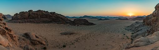 Wadi Rum Sunset VI. A panorama picture of Wadi Rum`s landscape at sunset royalty free stock images