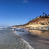 Wading на пляже стоковое фото