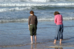 Wading. In the cold waters of the North Sea, Northumberland, North East of England Stock Images