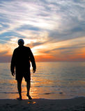Wading. Man wading in the ocean royalty free stock photos