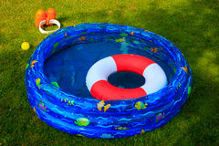 Wading pool on a summer day. Ocumentary Picture of a wading pool and swim gear during a Beautiful summer day Stock Image