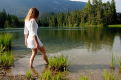Wading in Water. Young woman wading through water Royalty Free Stock Photography