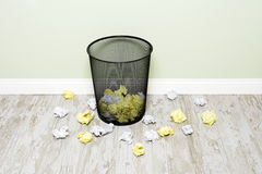 Wads of paper and trashcan Stock Image