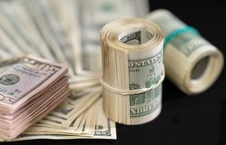 Wads and rolls of USD banknotes royalty free stock images