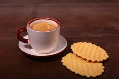 Wafel, caramel waffle and coffee cup, coffeebreak on dark background. Wafel, caramel waffle and coffee cup coffeebreak on dark background royalty free stock photo