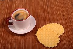 Wafel, caramel waffle and coffee cup, coffeebreak isolated on dark background. Wafel, caramel waffle and coffee cup coffeebreak isolated on dark background stock image