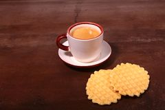 Wafel, caramel waffle and coffee cup, coffeebreak isolated on dark background. Wafel, caramel waffle and coffee cup coffeebreak isolated on dark background royalty free stock photos
