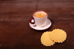 Wafel, caramel waffle and coffee cup, coffeebreak isolated on dark background. Wafel, caramel waffle and coffee cup coffeebreak isolated on dark background royalty free stock images