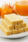 Wafer. Orange wafer on white dish with orange juice Stock Photography
