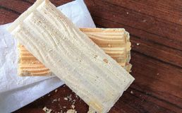 Wafer biscuit. On wood Royalty Free Stock Image