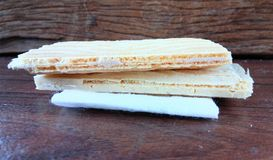 Wafer biscuit. On wood Royalty Free Stock Photo
