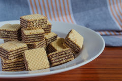 Wafer biscuits on saucer. On a wooden table Stock Image