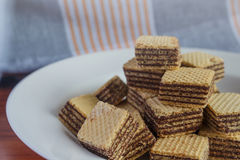 Wafer biscuits on saucer. On a wooden table Stock Photos