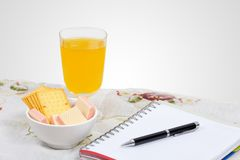Wafer, cheese crackers and empty note book. Royalty Free Stock Photos