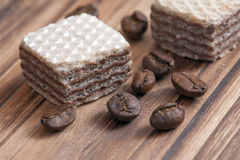 Wafer Coffee. And coffee bean on wood floor royalty free stock image
