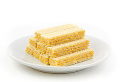 Wafer on dish. Orange wafer on white dish  with isolated Stock Photography