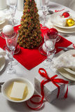 Wafer and gift on Christmas table. In home royalty free stock photography