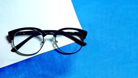 Wafer glasses_specs on blue and white clean background royalty free stock image