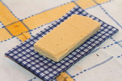 Wafer on a napkin. Wafer and napkin in a section on a cloth in a section Stock Photos