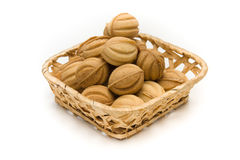 Wafer nuts with cream in a basket. Isolated Royalty Free Stock Images