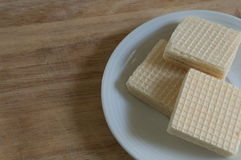 Wafer and plate on table Royalty Free Stock Photos