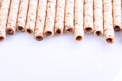 Wafer roll. Sticks cream rolls over a white background Royalty Free Stock Photo
