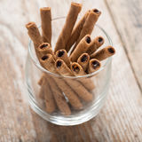 Wafer roll sticks cream rolls in a cup. Royalty Free Stock Photos