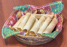 Wafer rolls on the brown table Stock Photography
