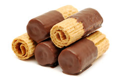 Wafer rolls in chocolate isolated on white backgro. Close-up of wafer rolls in chocolate isolated on white background Stock Photo