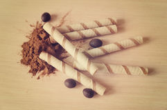 Wafer rolls and cinnamon. Wafer rolls, cinnamon and peanuts in cocoa Royalty Free Stock Image