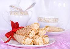 Wafer rolls with cream tied with red ribbon Royalty Free Stock Photo