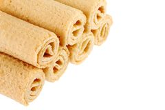 Wafer rolls. Gtoup of tasty crispy tube wafer isolated on white background. Dessert. There is some free space for your text or sign royalty free stock photo