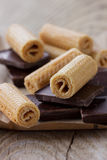 Wafer rolls with pieces of chocolate Stock Images