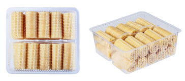 Wafer rolls in a plastic container, isolate on a white backgroun Stock Photo