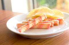Wafer rolls and potato chips Stock Images