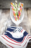 Wafer Stick in a wine glass. On wood floor Royalty Free Stock Photography